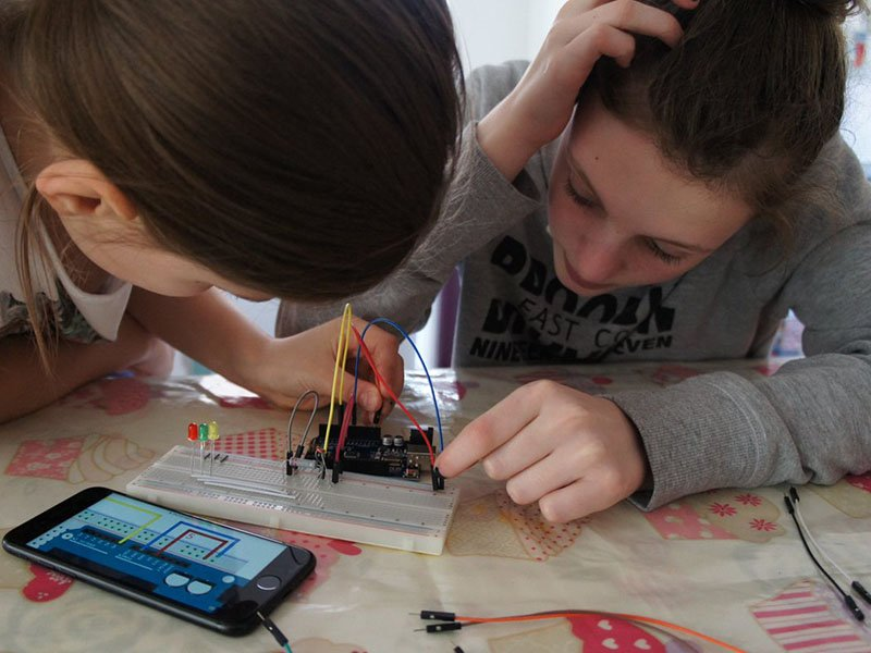 Two girls working on project