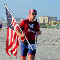 Man running with American Flag